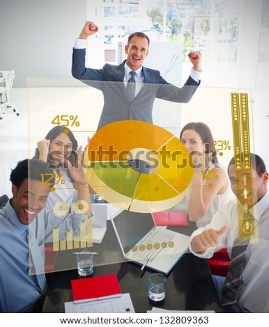 Cheerful business people using yellow pie chart interface in a meeting