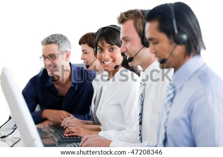 Cheerful business people working in a call center against a white background - stock photo