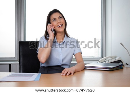 Cheerful business woman having conversation on phone call - stock photo