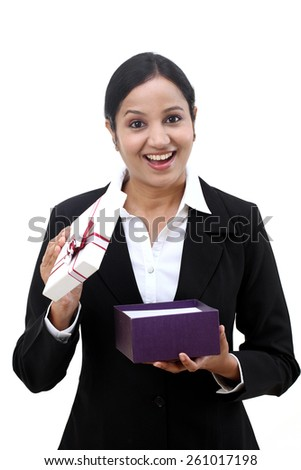 Cheerful business woman holding a gift box - stock photo