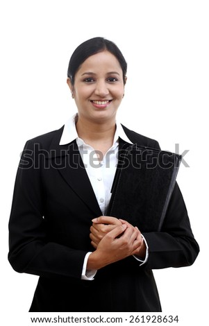 Cheerful business woman holding file - stock photo