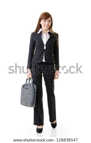 Cheerful business woman of Asian holding briefcase, full length portrait isolated on white background.