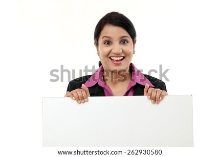 Cheerful business woman showing blank signboard - stock photo