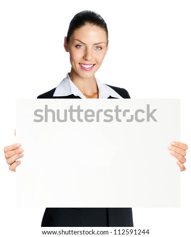 Cheerful business woman showing blank signboard, isolated over white background - stock photo