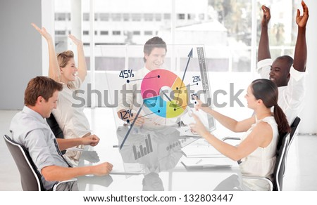 Cheerful business workers using colorful pie chart interface in a meeting