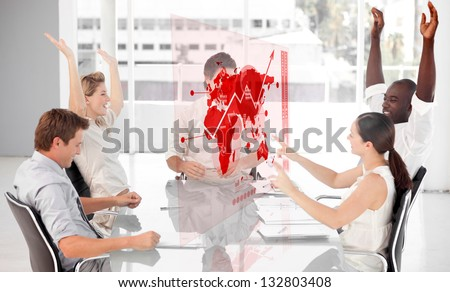 Cheerful business workers using red map diagram interface in a meeting - stock photo