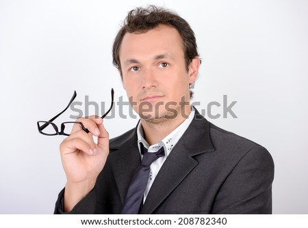Cheerful businessman. Handsome young man in formalwear and looking at camera - stock photo