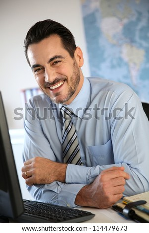Cheerful businessman in office