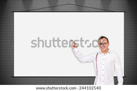 cheerful businessman pointing to a blank poster - stock photo