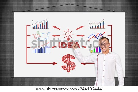 cheerful businessman pointing to poster with drawing  success strategy - stock photo