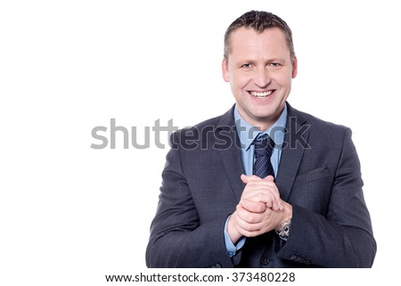 Cheerful businessman posing with his hands clasped - stock photo