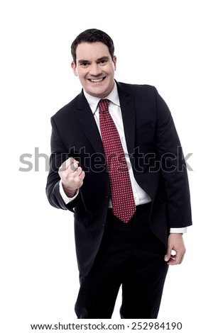 Cheerful businessman rejoicing for his success