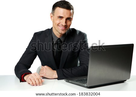Cheerful businessman sitting at the table with laptop isolated on a white background - stock photo