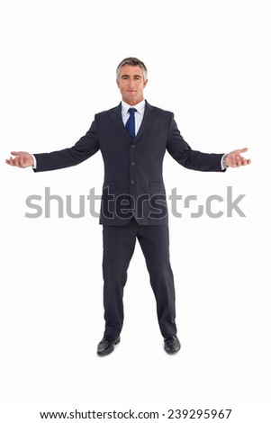 Cheerful businessman spreading his arms on white background