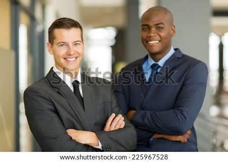 cheerful businessman standing in front of colleague - stock photo