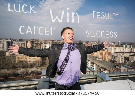 Cheerful businessman standing on the roof - stock photo