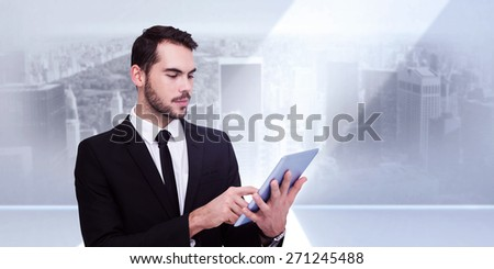 Cheerful businessman touching digital tablet against city scene in a room - stock photo