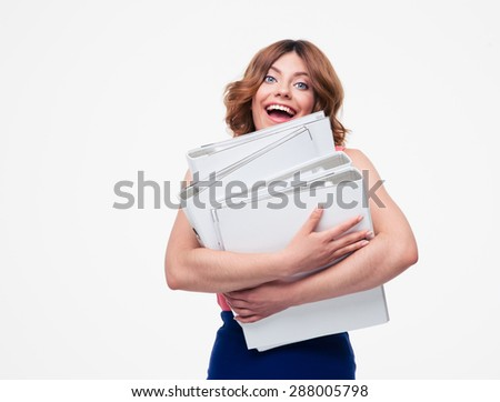 Cheerful businesswoman holding folders isolated on a white background. Looking at camera - stock photo