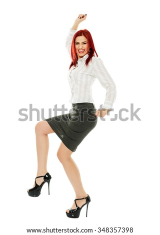 Cheerful businesswoman in full length, celebrating success - stock photo