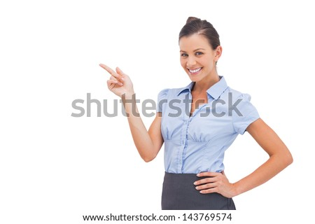 Cheerful businesswoman indicating something on the left - stock photo