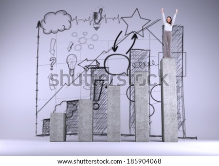Cheerful businesswoman on bar chart depicting growth - stock photo