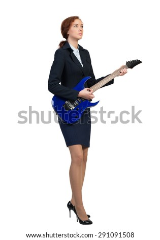 Cheerful businesswoman playing electronic guitar isolated on white background - stock photo
