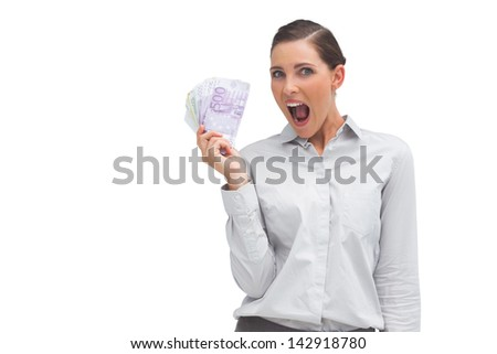 Cheerful businesswoman showing lot of money on white background