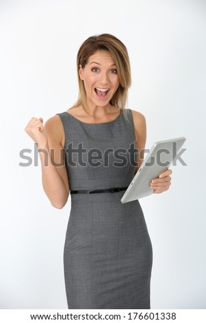 Cheerful businesswoman using digital tablet, isolated - stock photo