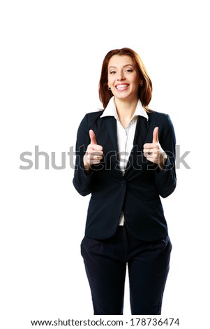 Cheerful businesswoman with thumbs up isolated on white background - stock photo