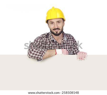 Cheerful capenter with blank board, white background - stock photo