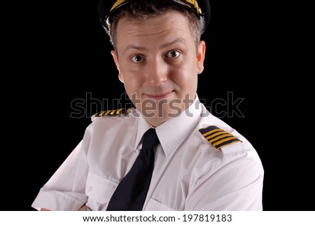 Cheerful captain in uniform on a black background