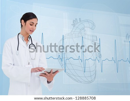 Cheerful cardiologist using a tablet pc in front of heartbeat line - stock photo