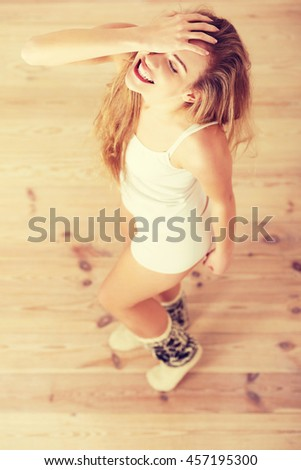 Cheerful, carefree young caucasian woman feels happy. - stock photo