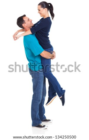 cheerful caucasian husband lifting his wife over white background