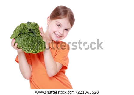 Cheerful caucasian little girl holding a head of cabbage/beautiful little with green cabbage (savoy) isolated over white background - stock photo