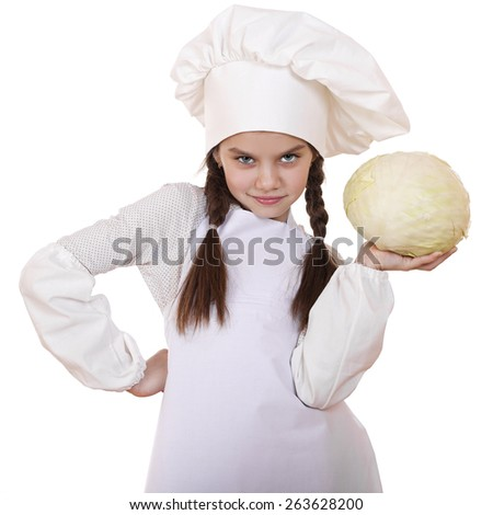 Cheerful caucasian little girl in cook hat holding a head of cabbage, isolated on white background