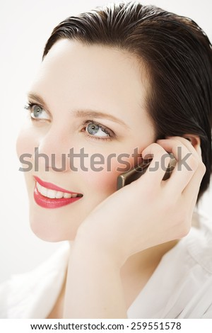 Cheerful Caucasian woman talking on mobile phone. - stock photo