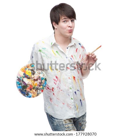 cheerful caucasian young male painter standing isolated on white
