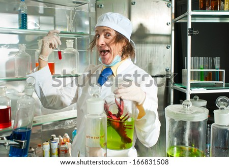 Cheerful chemist in a laboratory - stock photo
