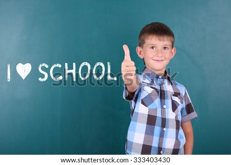 Cheerful child at the blackboard. I love learning concept - stock photo