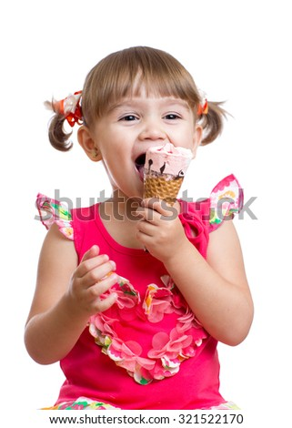 cheerful child girl eating ice-cream in studio isolated