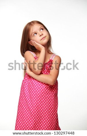 Cheerful child in a beautiful dress on white background - stock photo