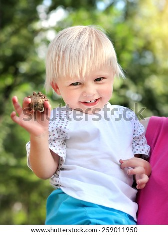 Cheerful Child in the Summer Park - stock photo