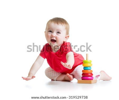 cheerful child little girl playing with colorful toy isolated on white