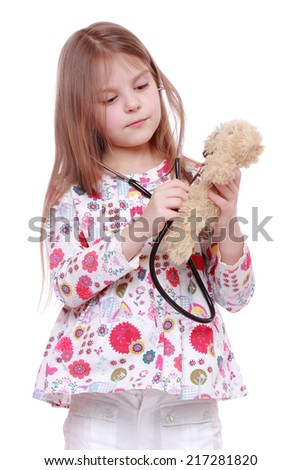 cheerful child playing with toy over white background