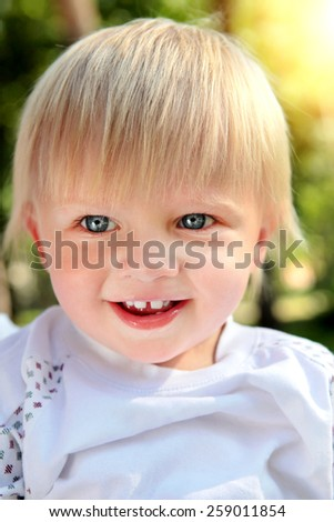 Cheerful Child Portrait at the Summer Park - stock photo
