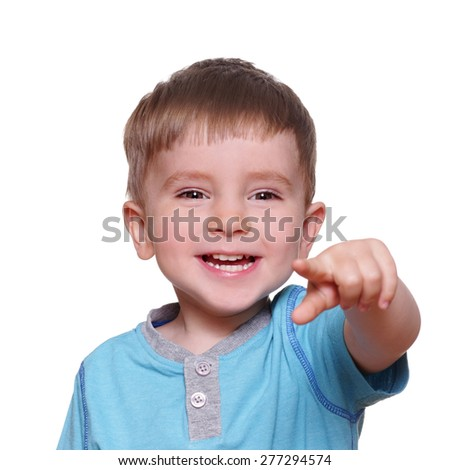 cheerful child shows finger forward  isolated on white background
