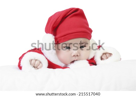 cheerful child wearing santa claus suit and something stare in studio