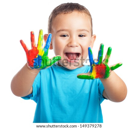 cheerful child with painted hands on white background - stock photo