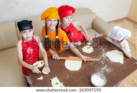 cheerful children cook pizza - stock photo